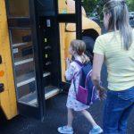 mum puting kids on bus
